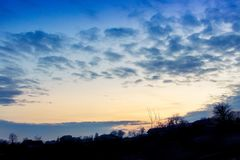 Landscape, sunset or sunrise, the sky covered with picturesque c. Louds Royalty Free Stock Photo