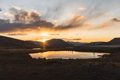 A pond reflection and landscape, sunset view at Independence Pass near Aspen, Colorado. A landscape, sunset view of the mountains and a pond reflection at royalty free stock image