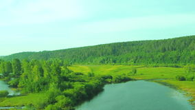 Landscape at sunset with views of the river. From the train stock footage