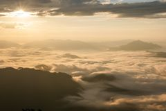 Landscape of sunshine on the morning mist at Phu Chee Fah. Chiangrai,Thailand Royalty Free Stock Photos