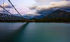Suspension bridge over the Mayer River. Landscape of the Suspension Bridge over the Mayer River. Villa Ohiggins and its mountains that surround it. Austral road stock images