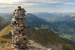 Landscape in the Swiss Alps. Tower of stones in the Swiss Alps Royalty Free Stock Photo