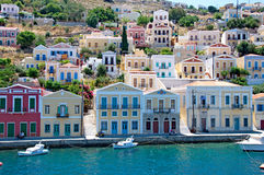 Landscape of Symi town and lagoon Stock Photos