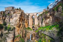 Tajo Gorge and stone bridge, Ronda, Spain. Landscape with the Tajo Gorge and stone bridge, Ronda, Spain royalty free stock image