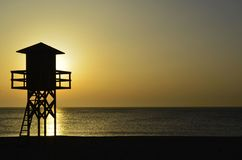 Lifeguard hut at sunrise in the Strait of Gibraltar royalty free stock image