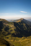 Landscape from the tallest peak in Romania. Almost clear blue sky, green mountains and valley royalty free stock photography