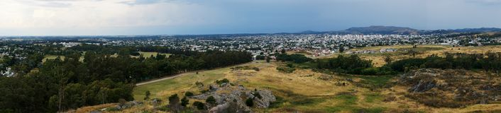 Landscape of Tandil city and the surrounding hills. Landscape of Tandil city, Buenos Aires, Argentina. Generic vegetation and a few hills also in the picture Royalty Free Stock Images
