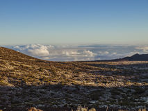Landscape - Tenerife, Spain (above the clouds). Volcanic landscape - stone - sand - hills - bushes - daylight Royalty Free Stock Photos