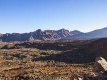 Landscape - Tenerife. Volcanic landscape - stone - sand - hills - bushes - bright daylight Stock Photo