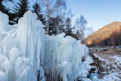 A landscape of thick ice in a mountainous terrain. A huge chunk of ice in a mountainous area of gangwon district stock photos