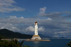 Landscape with three-faced Bodhisattva Guanyin located on the island in the sea. royalty free stock image