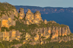 Landscape of The Three Sisters rock formation in the Blue Mounta. Ins of New South Wales, Australia, on the north escarpment of the Jamison Valley at sunset Royalty Free Stock Images
