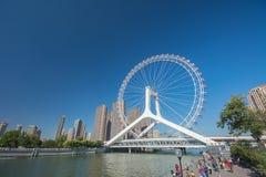 Landscape of Tianjin ferris wheel,Tianjin eye with people. Tianjin - October 3 : cityscape of Tianjin ferris wheel,Tianjin eye. Tianjin eye is the most popular stock image