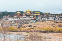 Landscape with tibetan monastery and lake Royalty Free Stock Photo