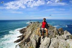Landscape with tourist on Cape Sizun. Stock Photos