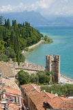 Landscape with tower (old town) of an Italian lake. The picture shows the landscape in Sirmione at the Gardasee, Italy, Europe Royalty Free Stock Photography