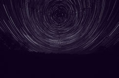 Landscape with tracks of stars. Around Polar star Royalty Free Stock Images