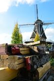 Landscape with traditional Dutch grain windmill, restoration pro Royalty Free Stock Image