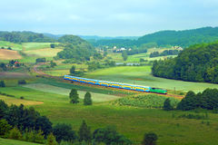 Landscape with train, lake and forest Royalty Free Stock Photos