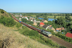 Landscape with the train, village and river royalty free stock photos