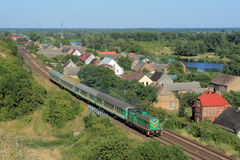 Landscape with the train, village and river Royalty Free Stock Photo