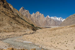 Landscape of Trango tower family, Lobsang spire and river, K2 tr. Ek, Pakistan, Asia Royalty Free Stock Images