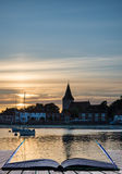 Landscape tranquil harbour at sunset with yachts in low tide Cre Stock Photography