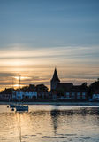 Landscape tranquil harbour at sunset with yachts in low tide Royalty Free Stock Photography