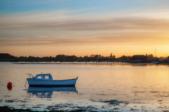 Landscape tranquil harbour at sunset with yachts in low tide Stock Photo
