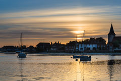 Landscape tranquil harbour at sunset with yachts in low tide Stock Image