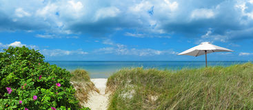 Landscape with trasit to the beach and sunshade Royalty Free Stock Image