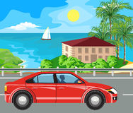 Landscape and travel. Idyllic seascape. The car goes on the road past the island Stock Photo