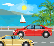 Landscape and travel. Idyllic seascape. The island and sailing yacht at sea and cars on the road Stock Image