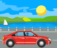 Landscape and travel. Idyllic seascape. The mountains and sailing yacht at sea. The cars on the road Royalty Free Stock Photos