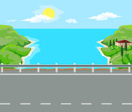 Landscape and travel. Idyllic seascape. Road and house with red roof on the island Royalty Free Stock Photos