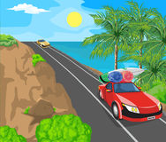 Landscape and travel. Idyllic seascape. The sun, blue sky and a wide road with mountains Stock Photos