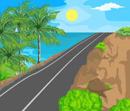 Landscape and travel. Idyllic seascape. The sun, blue sky and a wide road with mountains Royalty Free Stock Photo