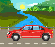 Landscape and travel. Idyllic summer landscape. The river and car on the road Royalty Free Stock Photography