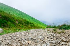Landscape, travel, tourism. Road with pebbles going to the mountains. Horizontal frame. Landscape, travel, tourism, background. Road with pebbles going to the Royalty Free Stock Photography