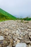 Landscape, travel, tourism. Road with pebbles going to the mountains. Horizontal frame. Landscape, travel, tourism, background. Road with pebbles going to the Stock Image