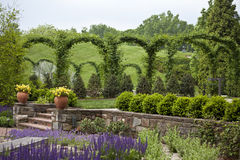 Landscape. With trees, shrubs and flowers  and a stone wall.  Longwood Gardens PA USA Royalty Free Stock Image