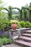 Landscape. With trees, shrubs and flowers  and a stone wall.  Longwood Gardens PA USA royalty free stock photography