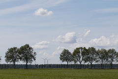 Landscape with trees and windmills Stock Photography