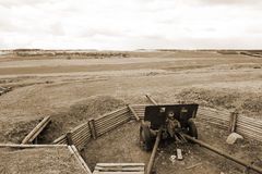 Landscape with trenches and gun. Sepia. Stock Photo