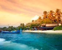Landscape of tropical island beach with palm trees. And cloudy blue sky Royalty Free Stock Image