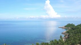 Landscape of tropical paradise coast with azure sea water in summer sunny day. slow motion. 3840x2160. Landscape of tropical paradise coast with azure sea water stock video