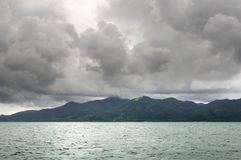 Landscape with tropical sea, monsoon storm heavy clouds and tropical Koh Chang island on horizon in Thailand royalty free stock images