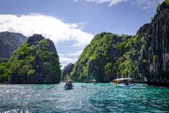 Landscape of tropical sea at sunny day. Palawan, Philippines - Apr 5, 2017. Many tourist boats run at Twin Lagoon in Palawan, Philippines. Palawan is one of the stock photos