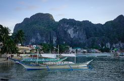 Landscape of tropical sea at sunny day. Palawan, Philippines - Apr 5, 2017. Tourist boats docking at El Nido Township in Palawan, Philippines. Palawan is one of royalty free stock photo