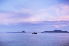 Landscape tropical sea. In twilight with boat stock images